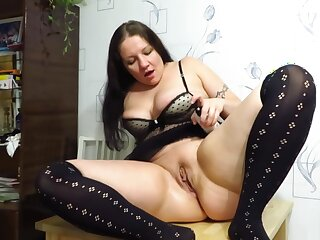 Mature girl fisting herself with hand and glass