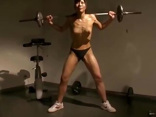 Unknown Asian Muscle Woman Topless, Crushes Apple At hand One Hand