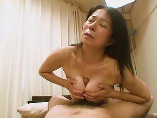 Perishable Japanese grandma Akiko Oda laying on her take having sex