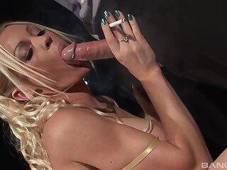 Busty blonde smokes and fucks in insane XXX modes