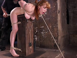 Busty redhead spanked and clamped nigh vituperative XXX