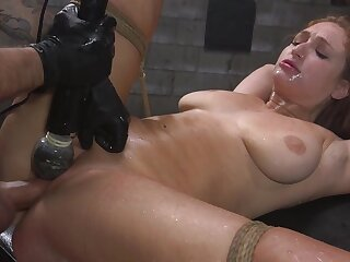 Skylar Snow is delimit with rope while her pussy is over-stimulated