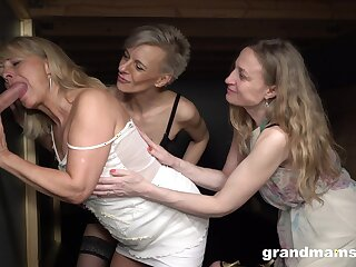 Three old women enjoy glory hole sex and fuck one young student