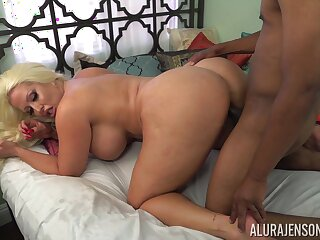 Awesome and super cruvaceous blonde MILF loves giving footjob to her stud