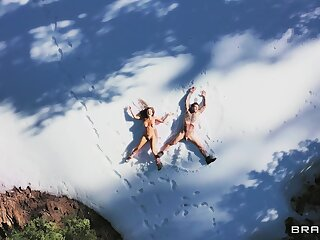 Outdoor sex in the snow for a tanned beauty with huge tits