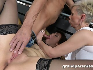 Two short-haired sluts hungrily share a stud's stiff endowment